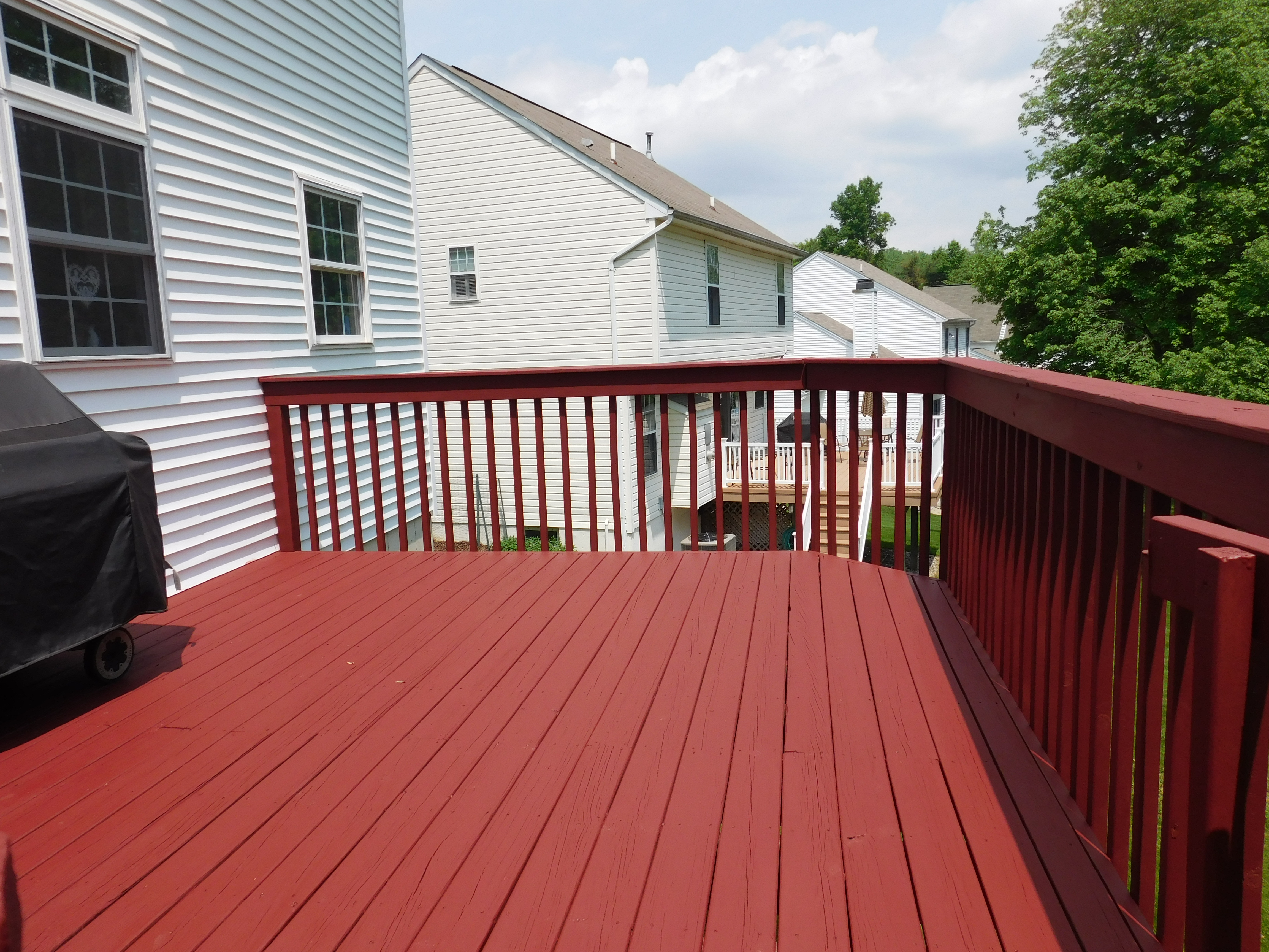 Deck staining downingtown deck sealing washing painting Classic red paint color