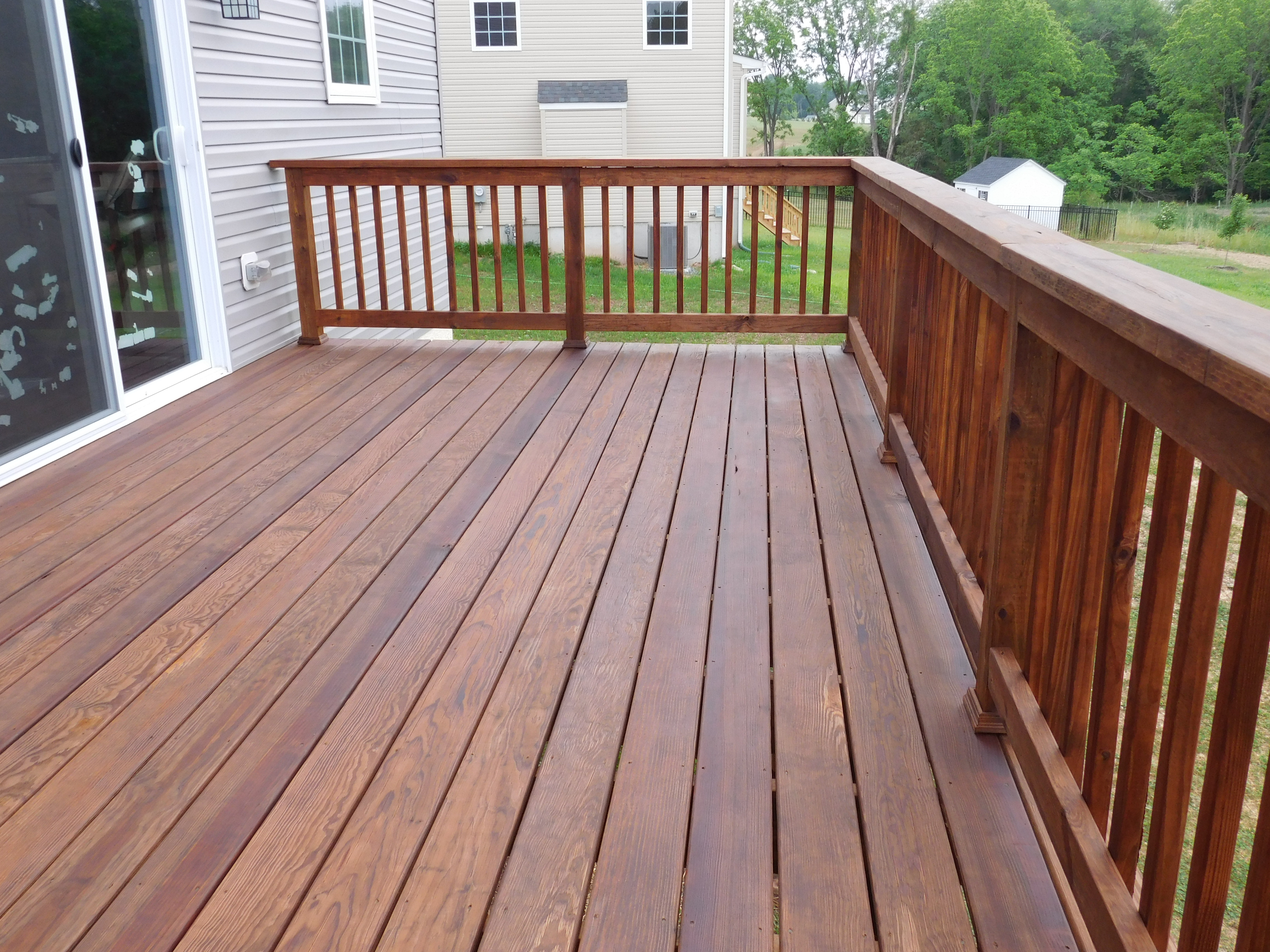 Deck staining royersford deck painting sealing washing for Balcony decking